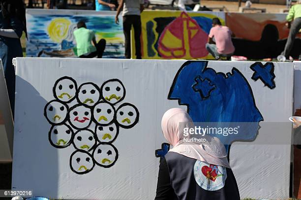 Palestinian art students take part in a festival marking the World Mental Health Day on October 11 2016 in Gaza City