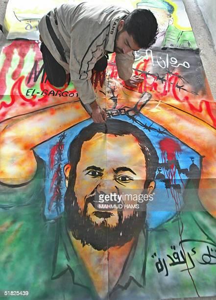Palestinian artist Baha alKhedra paints a mural of Jailed West Bank Fatah leader Marwan Barghuti at his studio in Gaza City 05 December 2004 Barghuti...