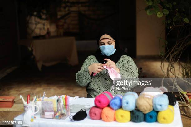 Palestinian artist Nouran Faraj makes protective Crochet Wool masks in her home amid the coronavirus disease outbreak in Gaza city on November 26 2020