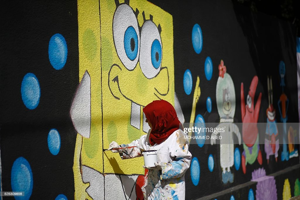 Palestinian artist paints murals on the walls of a school run by the ...