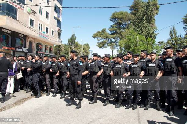 Palestinian authority anti-riot forces halt a protest against Obama's visit to Ramallah from reaching The Palestinian Authority's compound