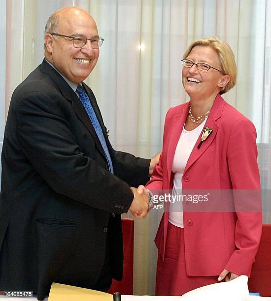 Palestinian Authority international cooperation minister Nabil Shaath shakes hands with Swedish foreign minister Anna Lindh after the EU foreign...