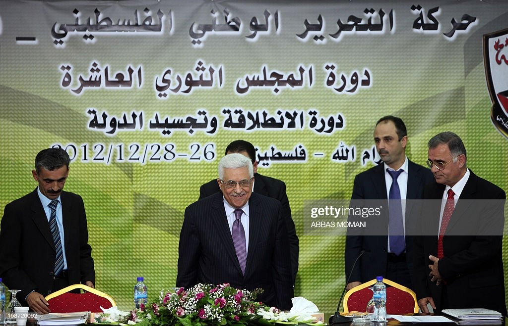 Palestinian Authority president and head of the Fatah movement Mahmud Abbas arrives to attend a Fatah 'Revolutionary Council' meeting in the Palestinian West Bank city of Ramallah along with top officials, on December 26, 2012.
