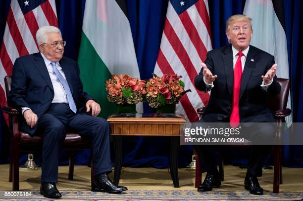 Palestinian Authority President Mahmoud Abbas listens while US President Donald Trump makes a statement for the press before a meeting at the Palace...