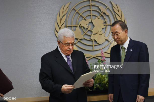 Palestinian Authority President Mahmoud Abbas pauses before formally submiting papers for statehood to United Nations SecretaryGeneral Ban Kimoon...