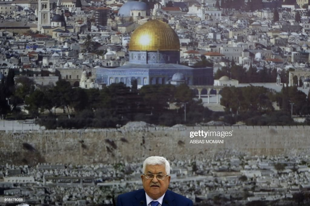 TOPSHOT - Palestinian Authority President Mahmud Abbas adresses the Palestinian leadership in the West Bank city of Ramallah on May 14, 2018. - Abbas condemned Israeli 'massacres' along the Gaza Strip border after Israeli forces killed 52 Palestinians during clashes and protests coinciding with the opening of the US embassy in Jerusalem. Abbas, who declared three days of mourning, also said the US is no longer a mediator in the Middle East,' adding the new embassy is tantamount to a new American settler outpost in Jerusalem.