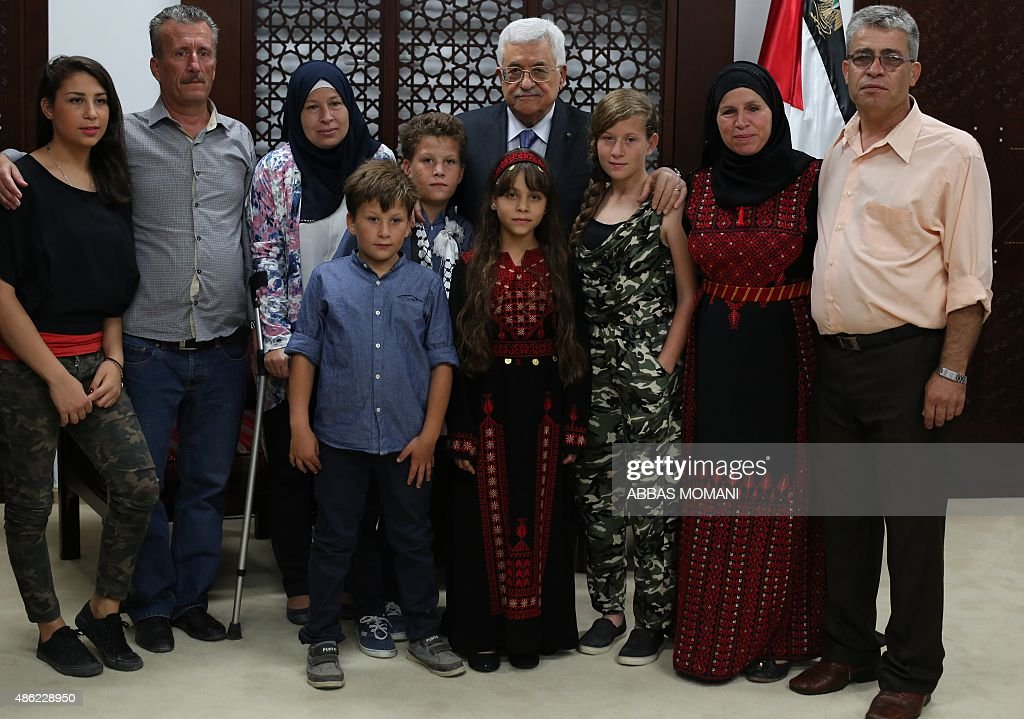 Palestinian Authority President Mahmud Abbas (C-back) receives at his headquarters in Ramallah on September 2, 2015, the Tamimi family, whose 11-year-old member Mohammed (5th L) was detained by an Israeli soldier during a weekly demonstration in the West Bank village of Nabi Saleh. Footage of the incident which took place on August 28 in the Israeli occupied West Bank went viral, generating a bitter debate both online and off. The Tamimi family has been at the forefront of the protests in the Palestinian village.