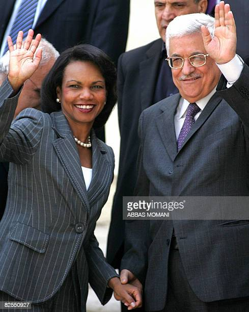 Palestinian Authority President Mahmud Abbas welcomes US Secretary of State Condoleezza Rice in the West Bank city of Ramallah on August 26 2008 The...