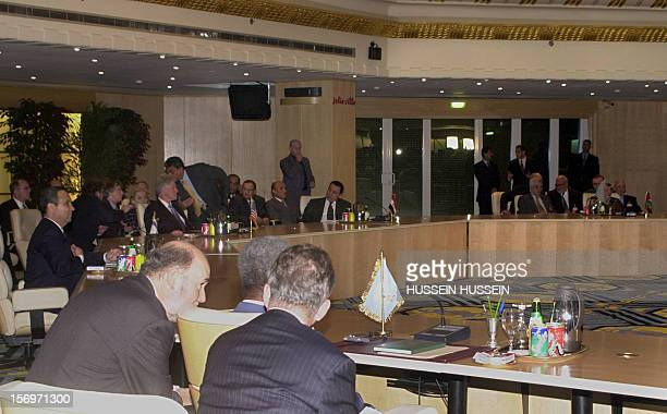 Palestinian Authority President Yasser Arafat and Israeli Prime Minister Ehud Barak attend the plenary session of the Middle East summit chaired by...