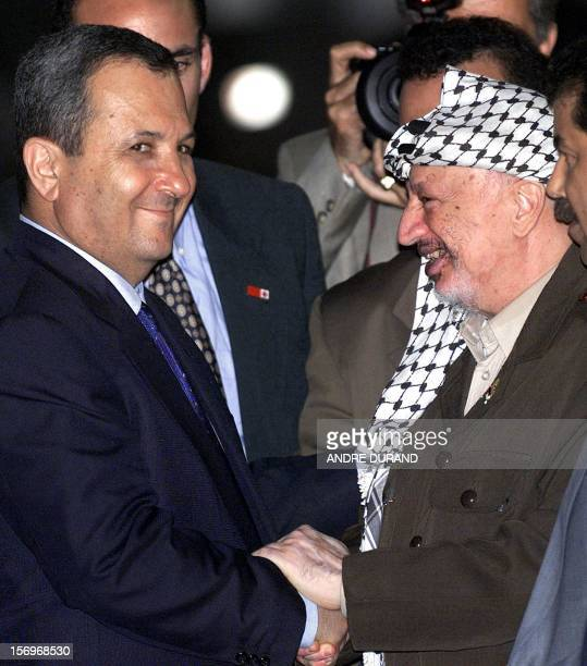 Palestinian Authority President Yasser Arafat shakes hands with Israeli Prime Minister Ehud Barak before their meeting at the Erez crossing point 27...