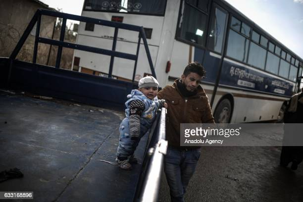 Palestinian baby is seen as people wait for passport control at the Rafah Border crossing after the gate temporarily reopened by Egyptian authorities...