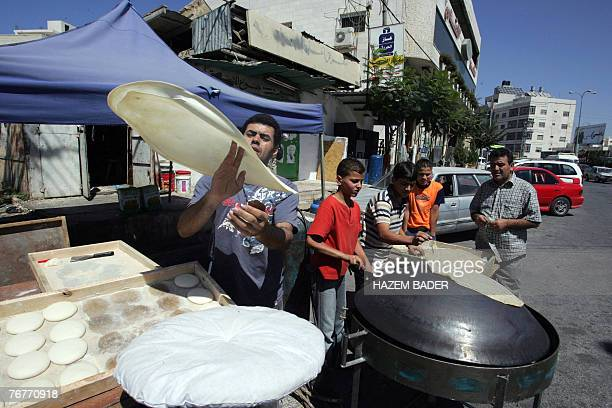 A Palestinian baker prepares a special thin bread known locally as 'shrak' for the Ramadan evening meal or 'iftar' that breaks the day's fasting in...