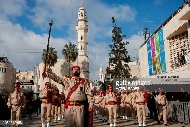 A Palestinian band performs on Manger square in front of the Church of the Nativity in the biblical West Bank city of Bethlehem on December 24 2018