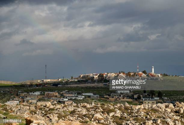 Palestinian Bedouin houses are pictured in front of the Israeli settlement of Adam, between Jerusalem and Ramallah in the occupied West Bank, on...