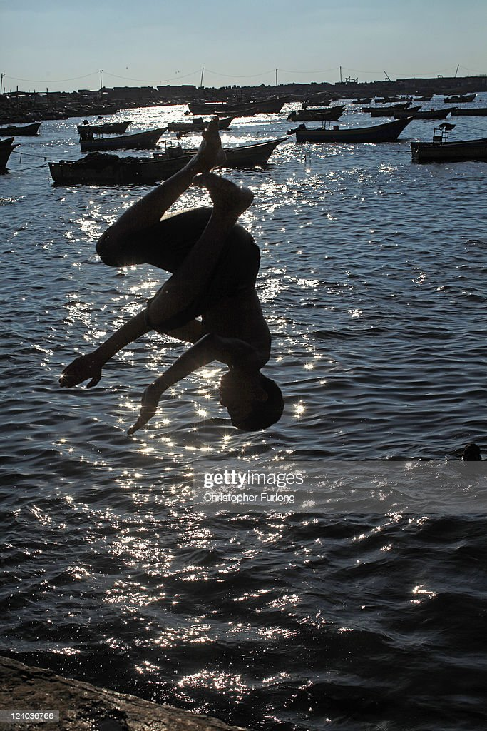 A Palestinian boy dives into the sea in the sea at Gaza City harbour on August 19, 2011 in Gaza City, Gaza. Palestinian President Mahmoud Abbas will formally submit the application for Palestinian statehood to the 66th United Nations General Assembly in New York on September 20th. The Palestinians and the Israelis are taking part in global diplomatic lobbying to win support for their differing positions on statehood. The Palestinian bid arises from two decades of on-and-off peace talks that have failed to produce a deal. The ultimate goal of the Palestinian Authority is to end Israeli occupation and to establish a sovereign and independent state on the 1967 borders with Jerusalem as its capital.