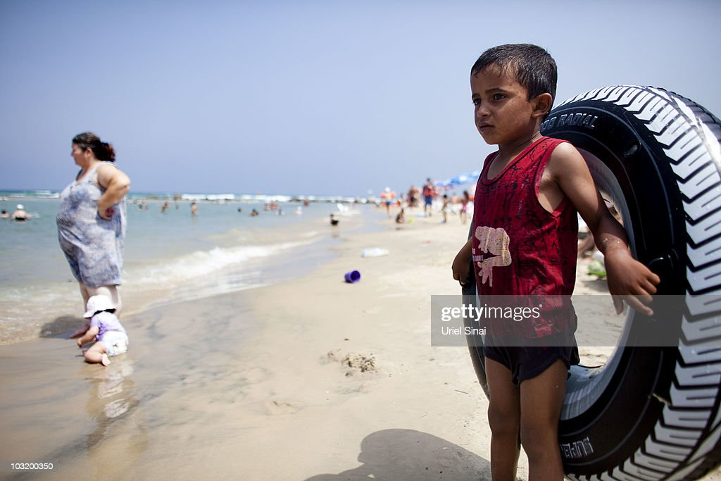 A Palestinian boy from the West Bank village of Jahalin looks on, as he spends the day at the beach on August 2, 2010 in Bat Yam, Israel. A group of Israeli women organize a weekly visit for Palestinian children from all over the West Bank to the the Israeli seaside, for most of the children this is the first time they get to the beach.