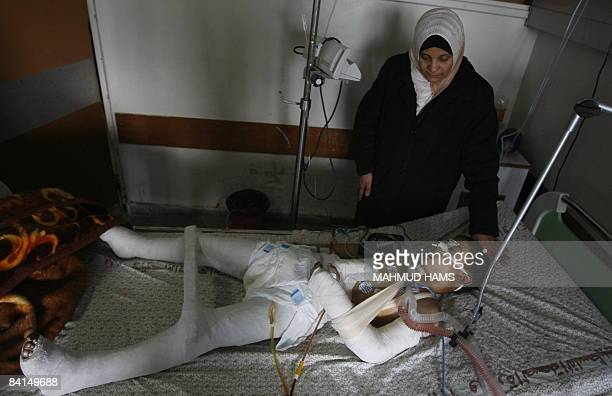 Palestinian boy Hosam Hamdan lies on December 31 2008 in Gaza City�s alShifa hospital intensive care unity after he was wounded and his two sisters...