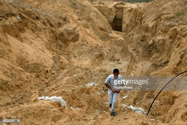 Palestinian boy looks at what used to be a tunnel leading from the Gaza Strip into Israel in the area of Rafah in the Southern Gaza Strip during the...