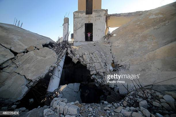 Palestinian boy plays in the rubble of mosque destroyed during the 50-day war between Israel and Hamas militants in the summer of 2014, in the...