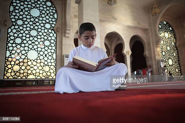 palestinian boy reads verses from the Koran Islam's holy book at alkhaldi mosque on the Muslim fasting month of Ramadan in Gaza City Ramadan is the...