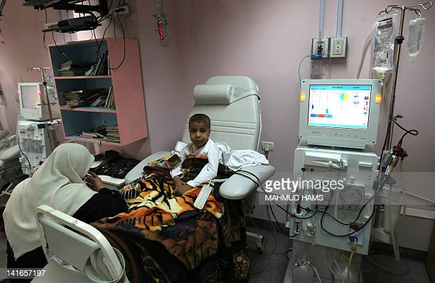 A Palestinian boy receives kidney dialysis at a hospital in Gaza City on March 21 2012 a day after the ministry of health in the Gaza Strip warned...