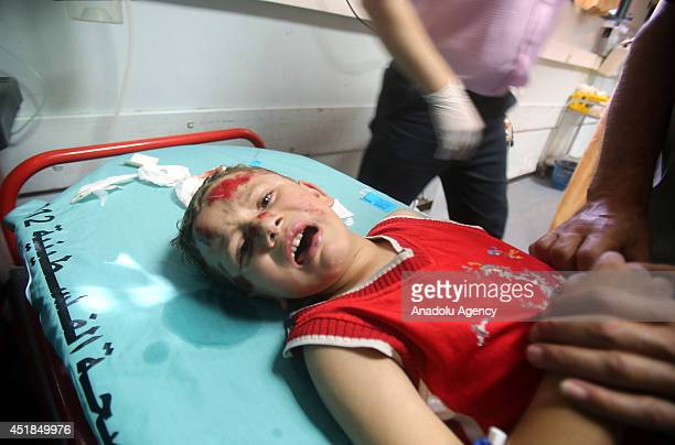 Palestinian boy receives treatment at a hospital after he was injured in an Israeli airstrike in Khan Younis southern Gaza Strip on July 8 2014 Seven...