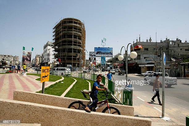 """Palestinian boy riding a bicycle in a street in Rafah in the southern Gaza Strip. Nakba, or """"catastrophe"""", marks Israel's founding in 1948 war, when..."""
