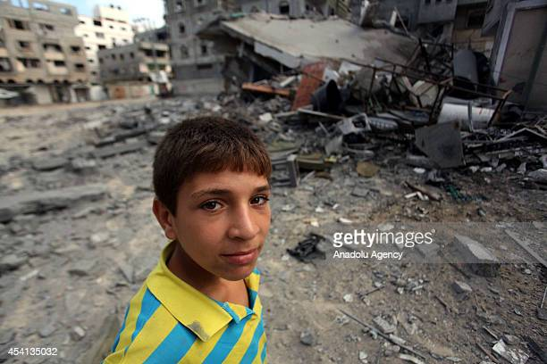 Palestinian boy stands next to the rubble of a destroyed house belonging to AlGuol family after an Israeli airstrike in AlShati Refugee Camp Gaza on...