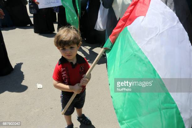 Palestinian boy supporter Hamas movement take part during a protest against US President Donald Trump comments linking Hamas with terrorism and...