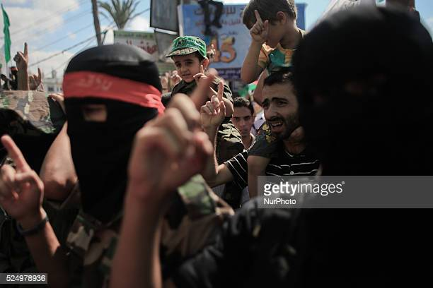 A Palestinian boy takes part in a rally marking 13th anniversary of the socalled AlAqsa uprising or 'Second Intifada' and against visits to a...