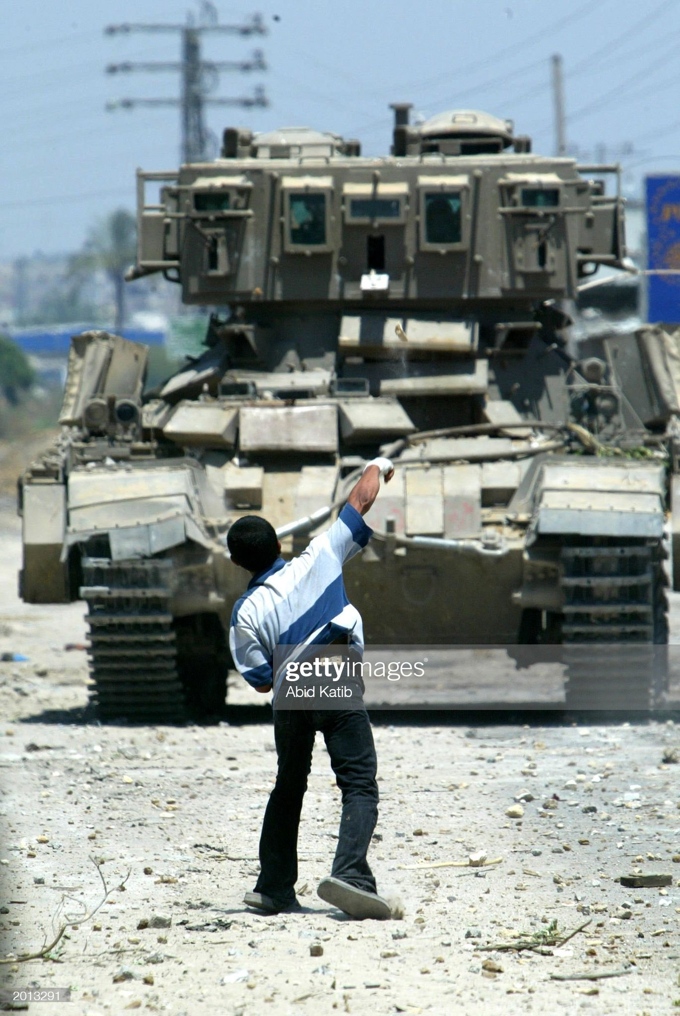 https://media.gettyimages.com/photos/palestinian-boy-throws-a-stone-at-an-israeli-tank-during-a-clash-may-picture-id2013291?s=2048x2048