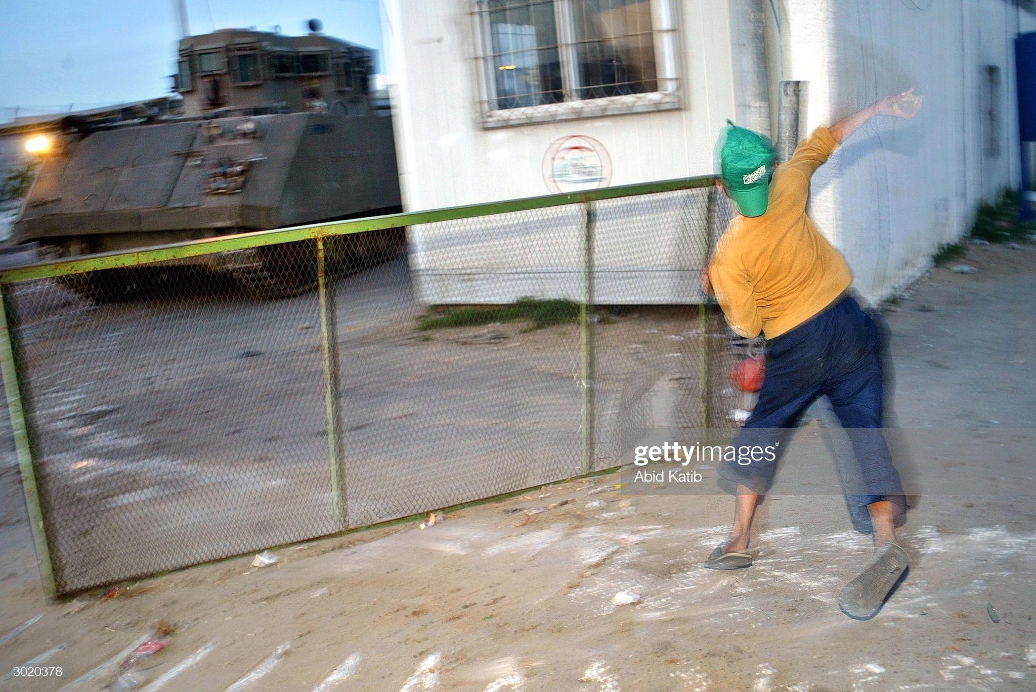 https://media.gettyimages.com/photos/palestinian-boy-throws-stones-towards-an-israeli-tank-while-destroy-picture-id3020378?s=2048x2048