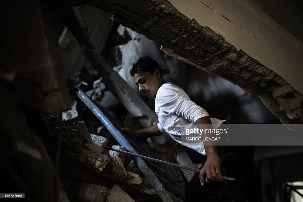 A Palestinian boy tries to enter his house destroyed in an Israeli airstrike on November 20, 2012. Israeli leaders discussed an Egyptian plan for a truce with Gaza's ruling Hamas, reports said, before a mission by the UN chief to Jerusalem and as the toll from Israeli raids on Gaza rose over 100.