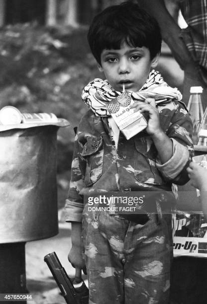 A Palestinian boy wait to leave Lebanon with the last Palestinian Liberation Organisation soldiers 30 August 1982 in Beirut In August and September...