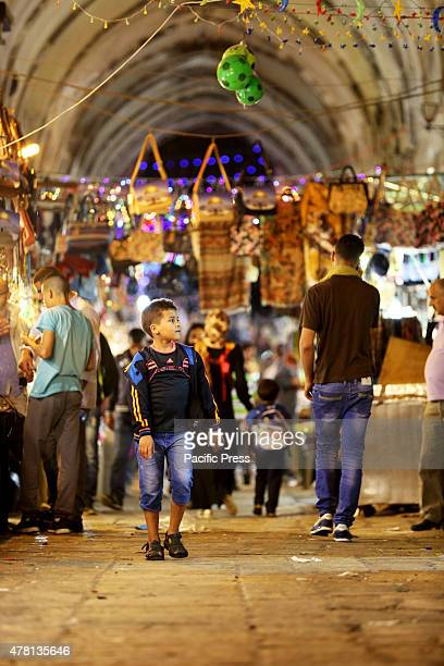 Palestinian boy walks around the old city of Eastern Jerusalem close to the entrance of Al Aqsa Mosque The streets of Jerusalem during the evening...