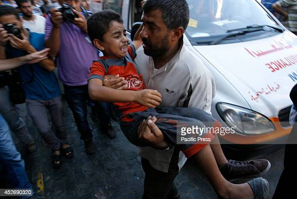 Palestinian boy wounded following an Israeli air strike arrives at a hospital in Khan Yunis in the southern Gaza Strip Israeli tanks and warplanes...
