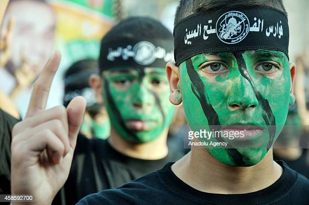 Palestinian boys are seen during a graduation ceremony of a military camp organized by Hamas at the Jabalia refugee camp in Jabalia, Gaza on November...