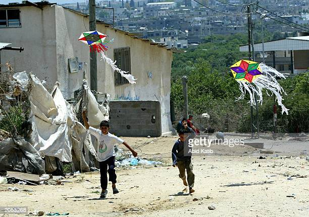 Palestinian boys fly kites June 3 2003 at Beit Hanoun town in northern Gaza Strip Palestinian children in Beit Hanon do not have many open spaces...