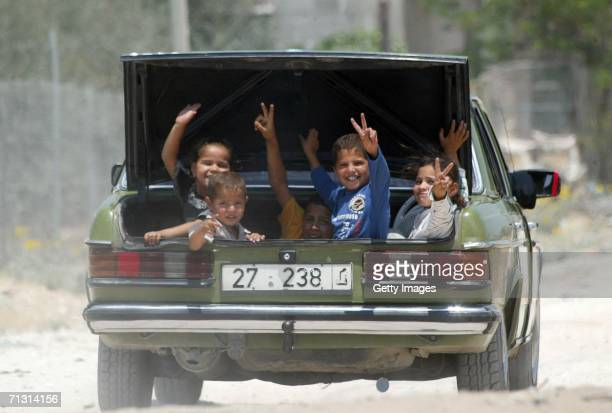 Palestinian boys leave in a car as they evacute their home located closely to the Gaza International Airport following an Israeli overnight operation...