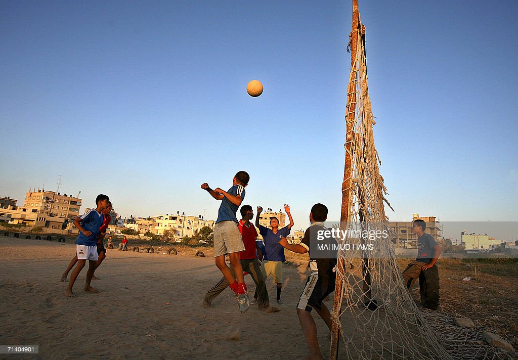 Palestinian boys play football in Gaza City 09 July 2006. Italy and France named full-strength teams as they prepared for their World Cup final collision in Gernamy today. France are aiming to win football's biggest prize for the second time in eight years while Italy will become the most successful European nation in World Cup history if they claim a fourth crown.