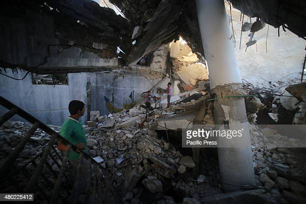 Palestinian boys play in the rubble of mosque destroyed during the 50-day war between Israel and Hamas militants in the summer of 2014, in the...