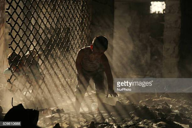 Palestinian boys play on the rubbles of houses which were destroyed during the recent Israeli war 2014 in Gaza city on April 30 2016 Israels punitive...