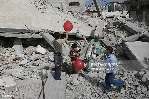 Palestinian boys play with baloons in the rubble of houses destroyed during Israel's 22day 'Operation Cast Lead' in Jabalia in the northern Gaza...