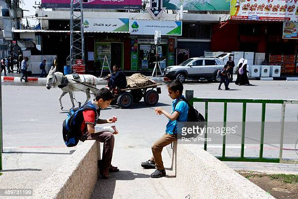 "Palestinian boys sit in a street in Rafah in the southern Gaza Strip. Nakba, or ""catastrophe"", marks Israel's founding in 1948 war, when hundreds of..."
