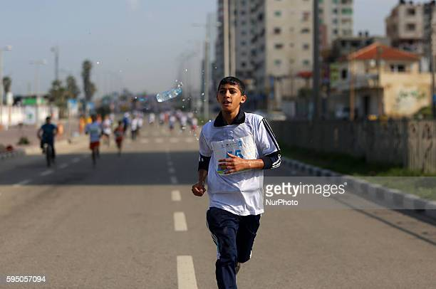 Palestinian boys take part in a marathon On the occasion of World Children's Day in gaza city on November 19 2015