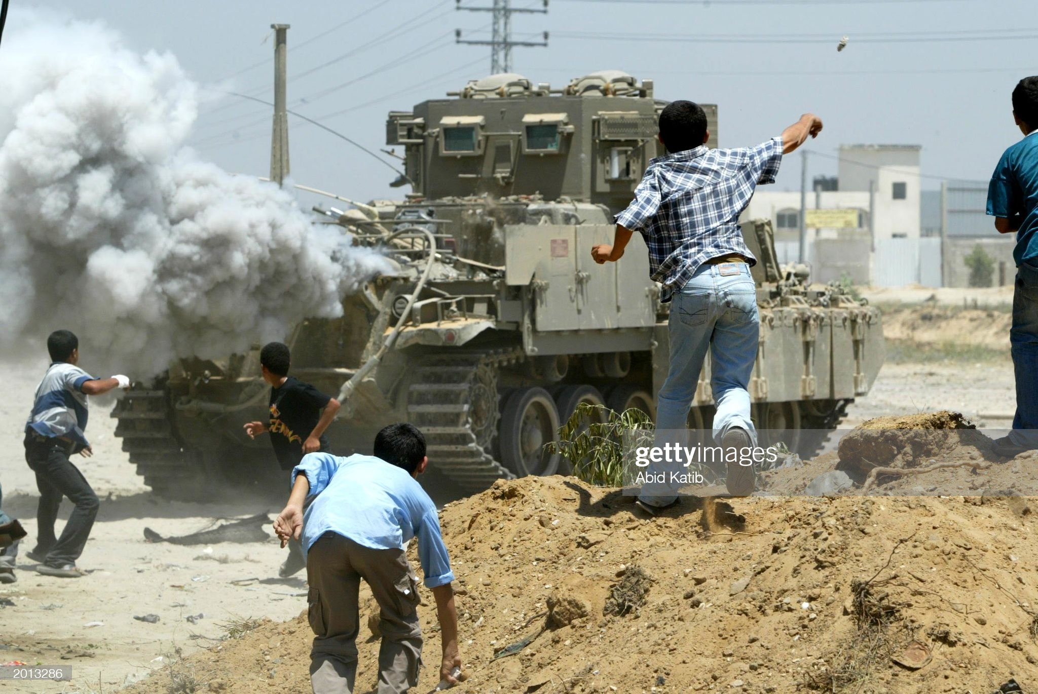 https://media.gettyimages.com/photos/palestinian-boys-throw-stones-at-an-israeli-tank-during-a-clash-may-picture-id2013286?s=2048x2048