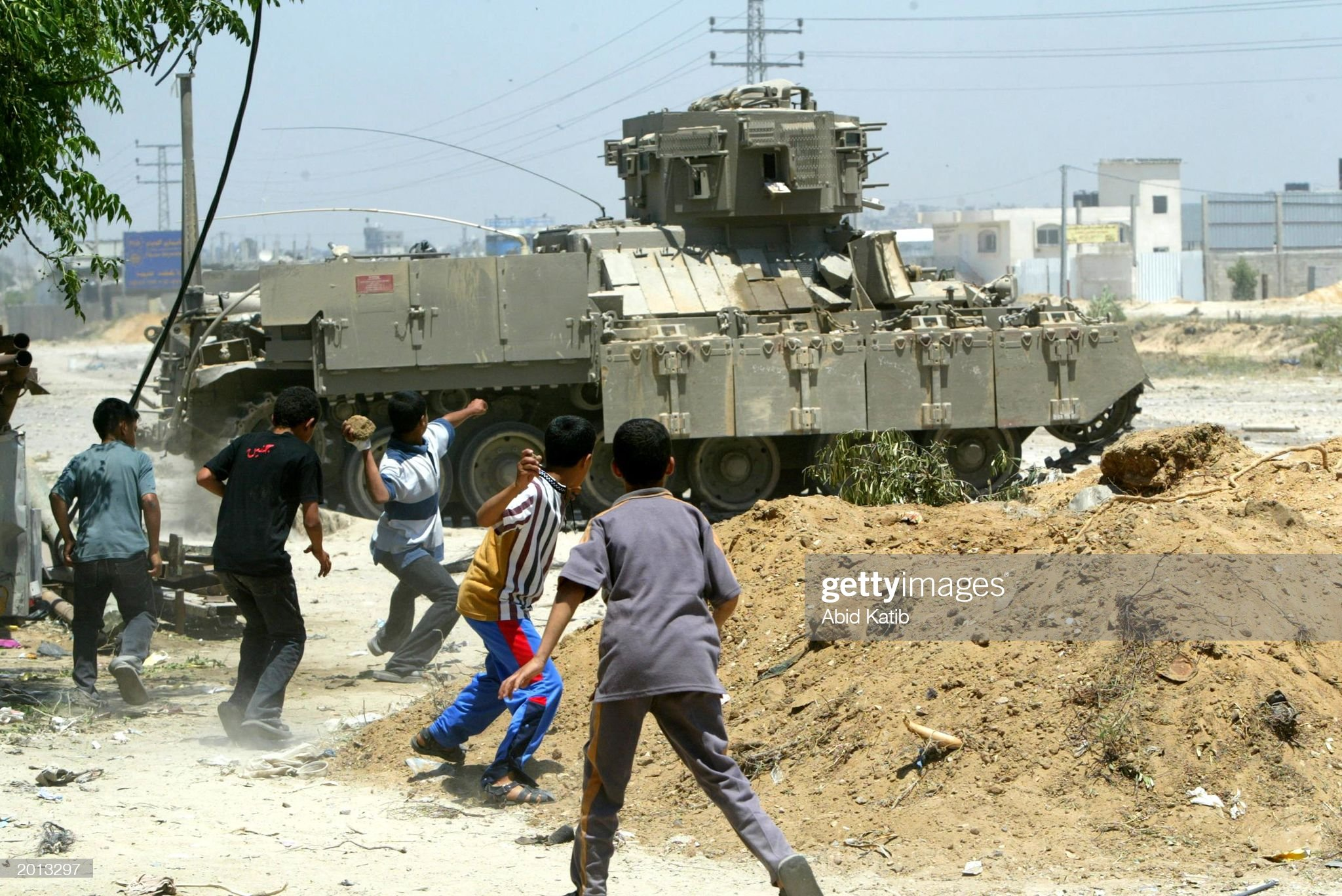 https://media.gettyimages.com/photos/palestinian-boys-throw-stones-at-an-israeli-tank-during-a-clash-may-picture-id2013297?s=2048x2048