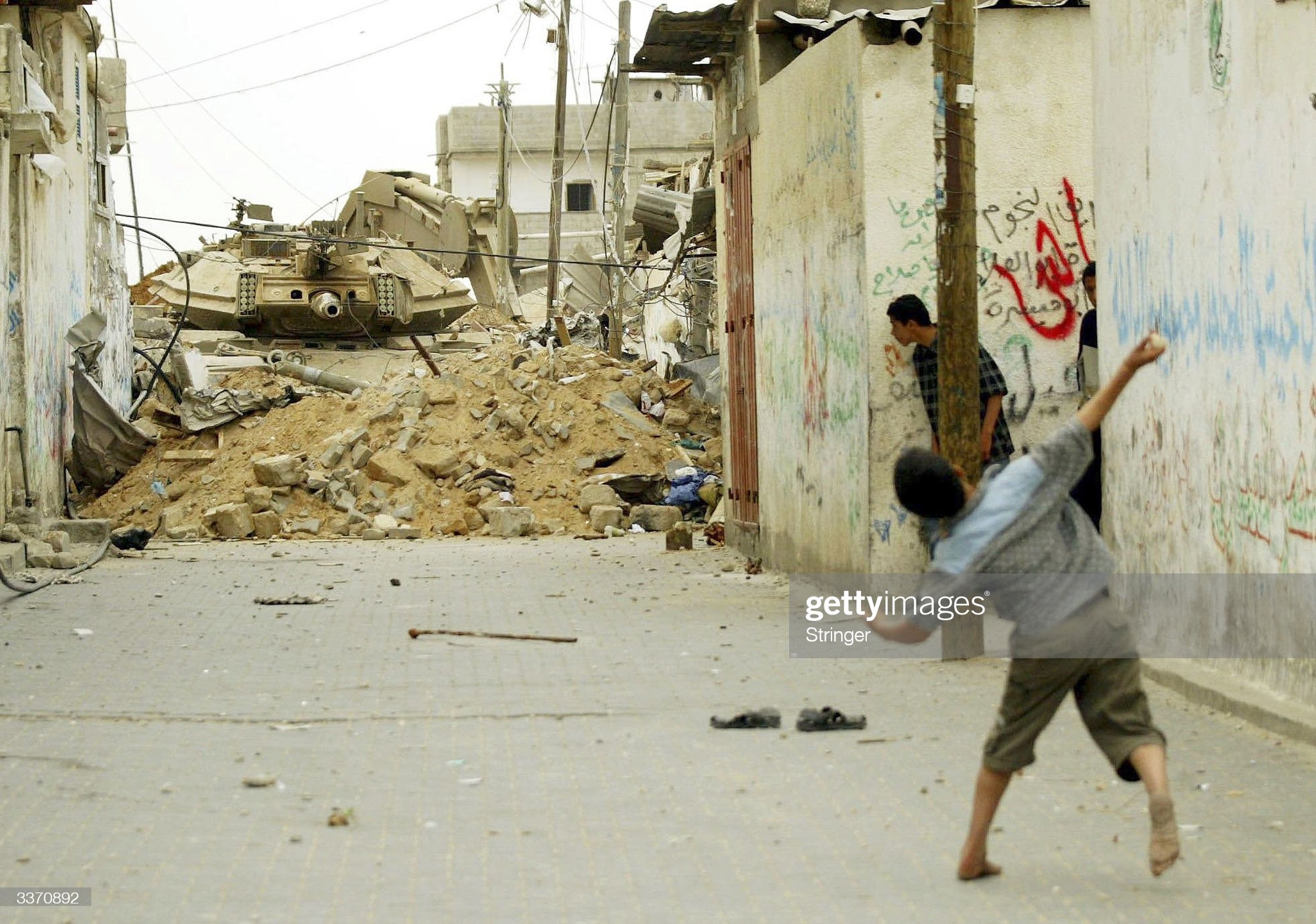 https://media.gettyimages.com/photos/palestinian-boys-throw-stones-towards-an-israeli-tank-during-an-army-picture-id3370892?s=2048x2048