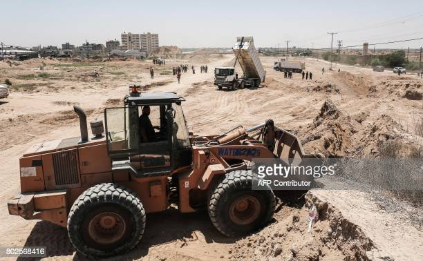 Palestinian bulldozers clear an area as Hamas begins creating a large buffer zone on the border with Egypt in the southern Gaza strip town of Rafah...