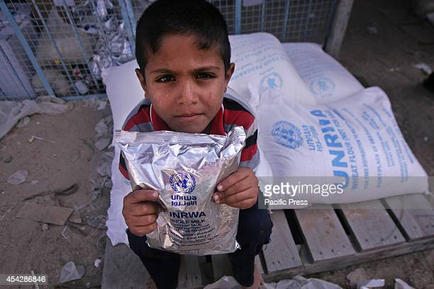 Palestinian child carrying an aid package from the UNRWA after the war ended officially in Rafah Southern Gaza strip